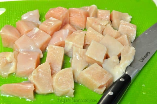 Chicken breasts are cut into chunks for honey lime chicken skewers.