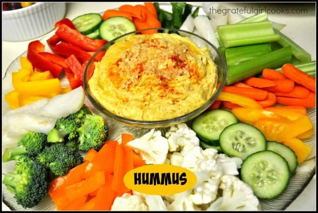 Creamy hummus, with minced garlic, is an easy to make from scratch dip to serve as an appetizer with pita chips, pita bread or fresh vegetables.