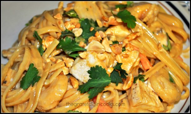 A portion of the Thai chicken linguini, garnished with cilantro and chopped peanuts.