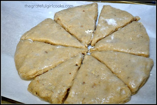 Scones divided into 8 wedges on parchment paper