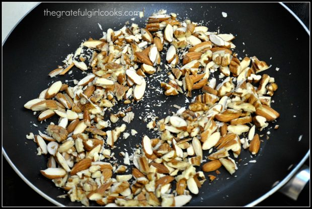Sliced almonds are lightly toasted in a dry skillet.