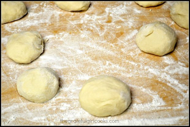 The tortilla dough is shaped into 8 equal sized dough balls.