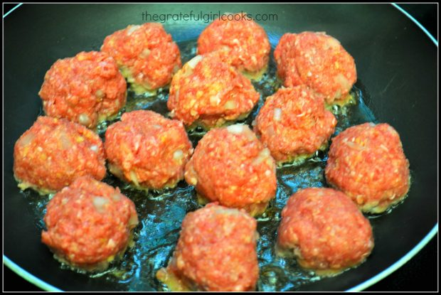 Meatballs are cooked on all sides until browned.
