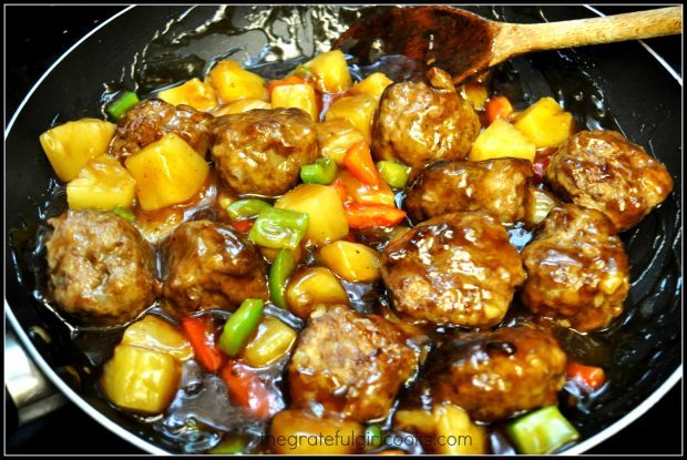 Hawaiian meatballs are added to sauce, peppers and pineapple.