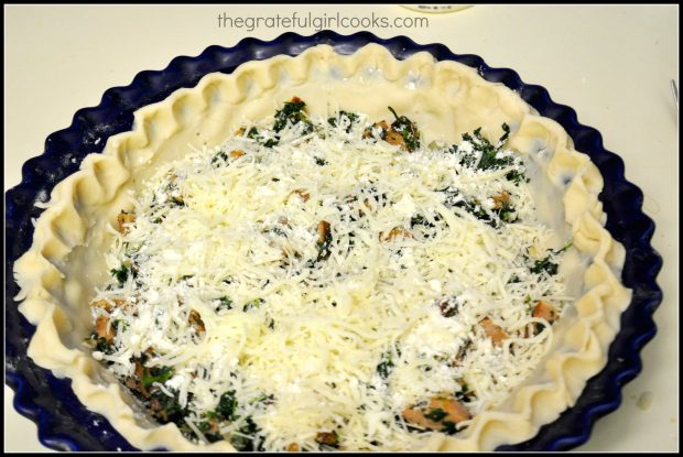 Cheeses and meat mixture is added to the unbaked pie crust.