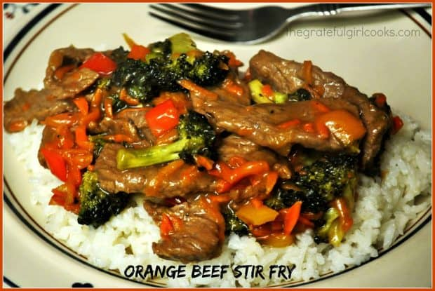 Enjoy an Orange Beef Stir Fry, with marinated steak cooked with broccoli, carrots and red bell peppers, in an Asian-inspired soy and marmalade sauce!