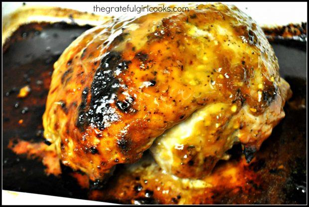 Orange glazed pork roast is finished baking and rests for a few minutes before slicing.