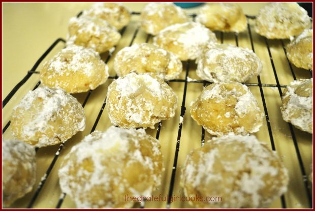 Snowball cookies, cooling on a wire rack.