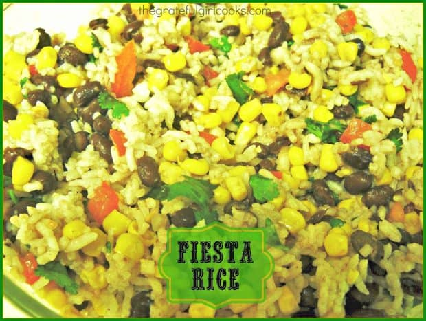Fiesta Rice is a totally EASY, hearty, and delicious side dish made with white rice, black beans, corn, tomatoes, scallions, cilantro and lime juice.
