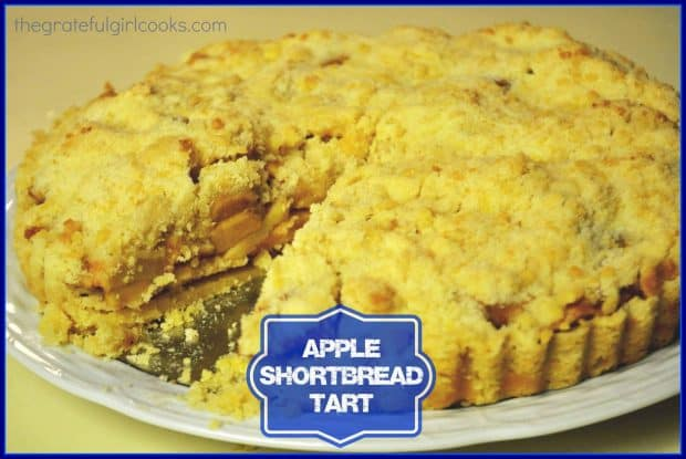 Delicious Apple Shortbread Tart features apples in a brown sugar/cinnamon sauce on a buttery shortbread crust , topped with a crumbly streusel. SO GOOD!
