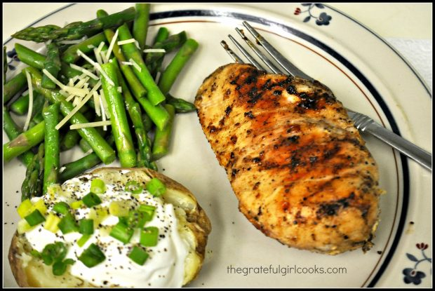 Grilled chicken basting sauce covered chicken breast, served with baked potato and asparagus!
