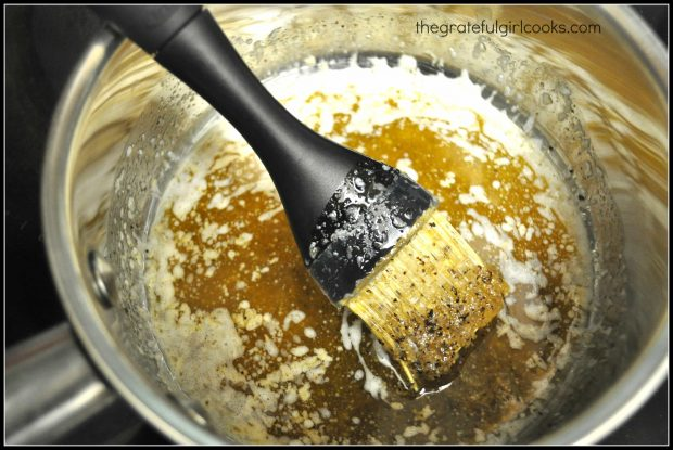 Spices added to melted butter to make easy basting sauce for chicken