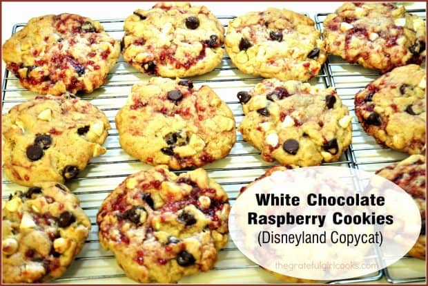 White Chocolate Raspberry Cookies are Disneyland Main Street favorites, filled with white & semi-sweet chocolate chips and ribbons of raspberry jam.