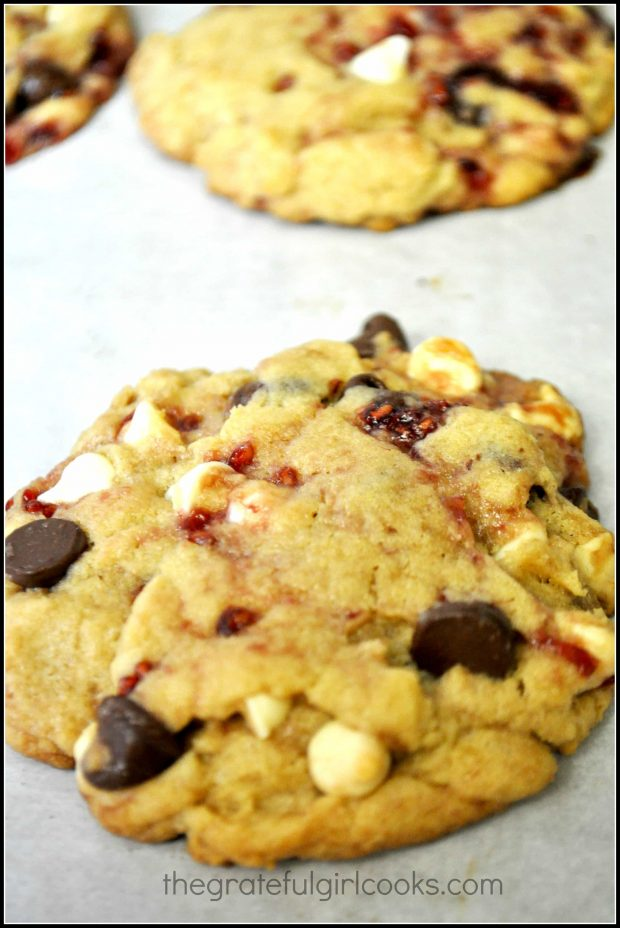 The baked white chocolate raspberry cookies are golden brown around edges.