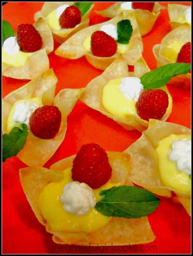 Lemon curd won ton cups, topped with raspberry, whipped cream and mint.