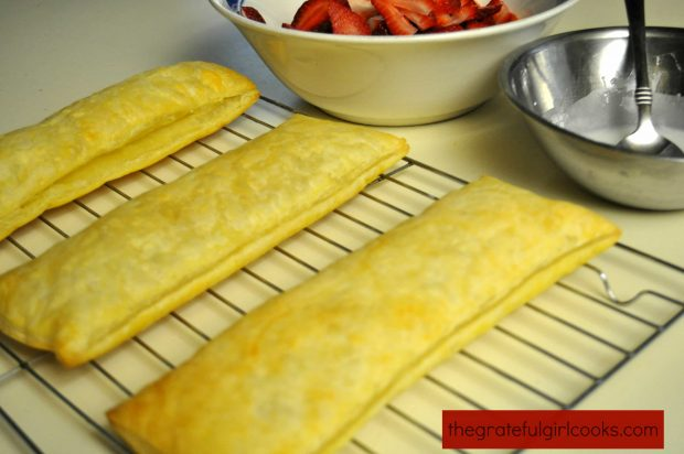 Baked puff pastry, ready to slice and fill for chocolate strawberry napoleons dessert.