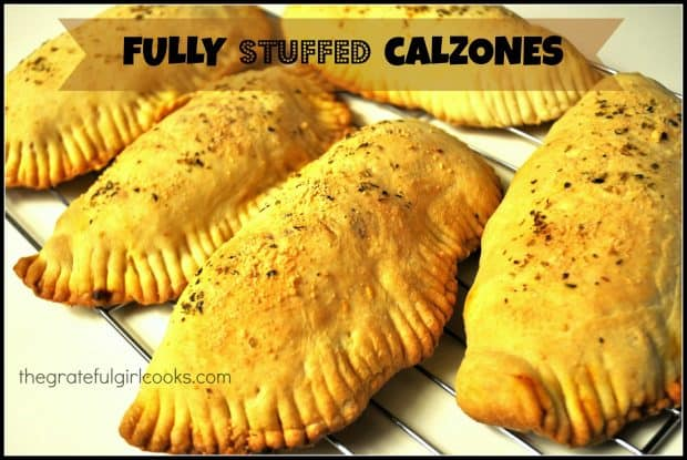 """Fully stuffed calzones are yummy baked """"Italian hand pies"""", filled with Italian sausage, pepperoni, green peppers, mushrooms, mozzarella cheese, etc."""