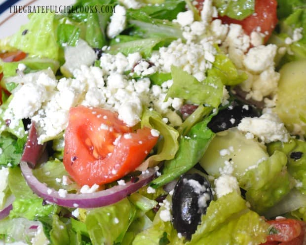 Greek salad, with red onions, tomatoes, cucumbers and kalamata olives.