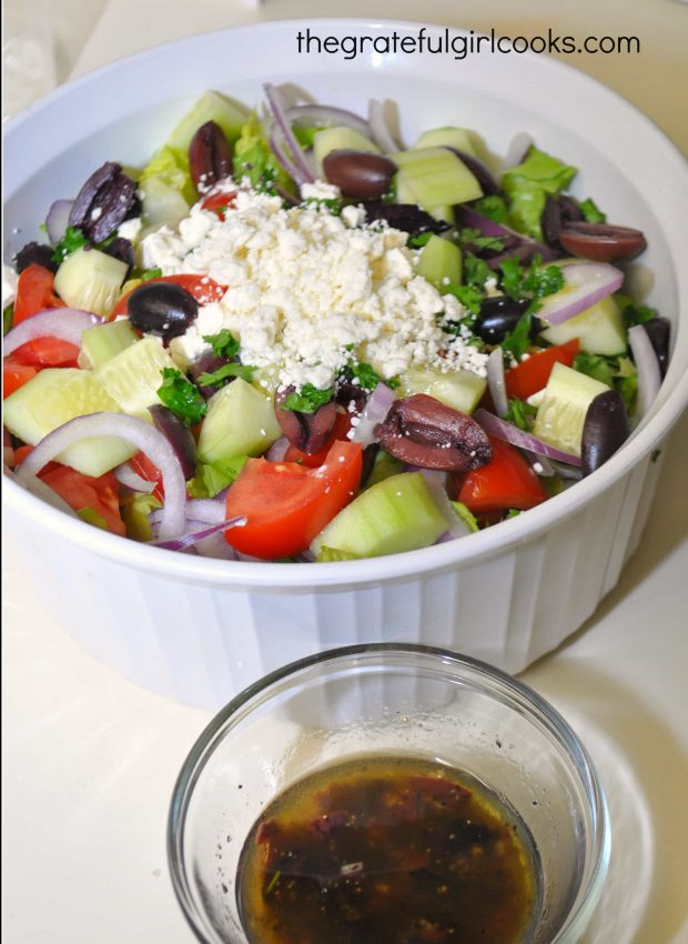 Feta cheese and kalamata olives are added to the Greek salad. Homemade salad dressing on side.