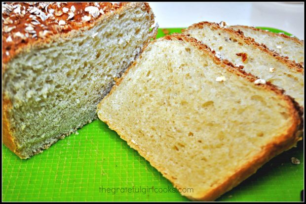 Slices cut from honey oat bread on green plastic mat
