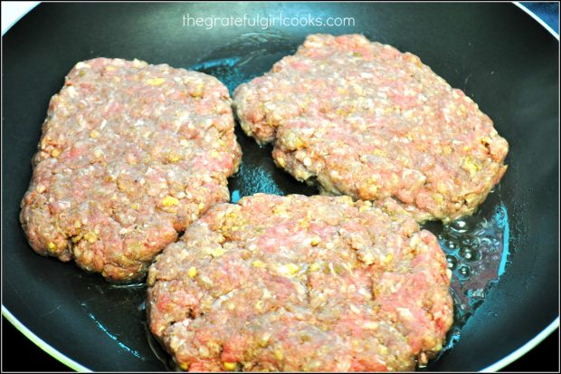 Salisbury steak patties are pan-seared in skillet.