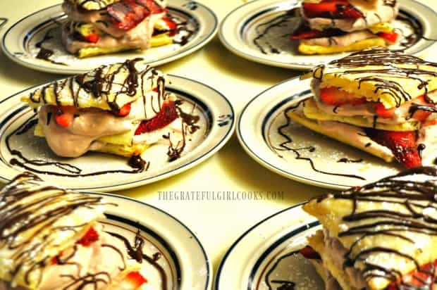 Chocolate strawberry napoleons on plates, ready to serve to guests!