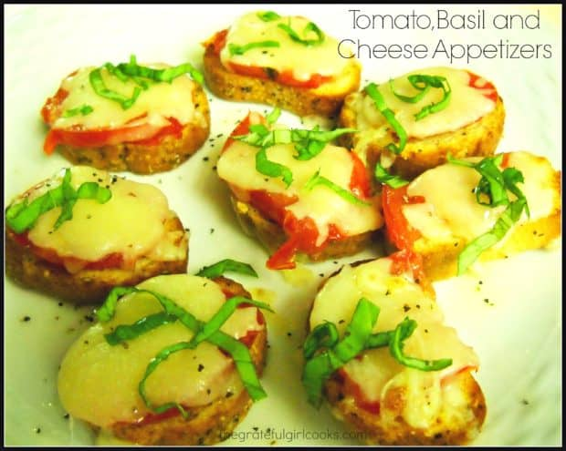 Tomato Basil Cheese Appetizers feature Roma tomatoes, fresh basil, and melted mozzarella cheese, resting on top of a garlic/oil infused french baguette slice