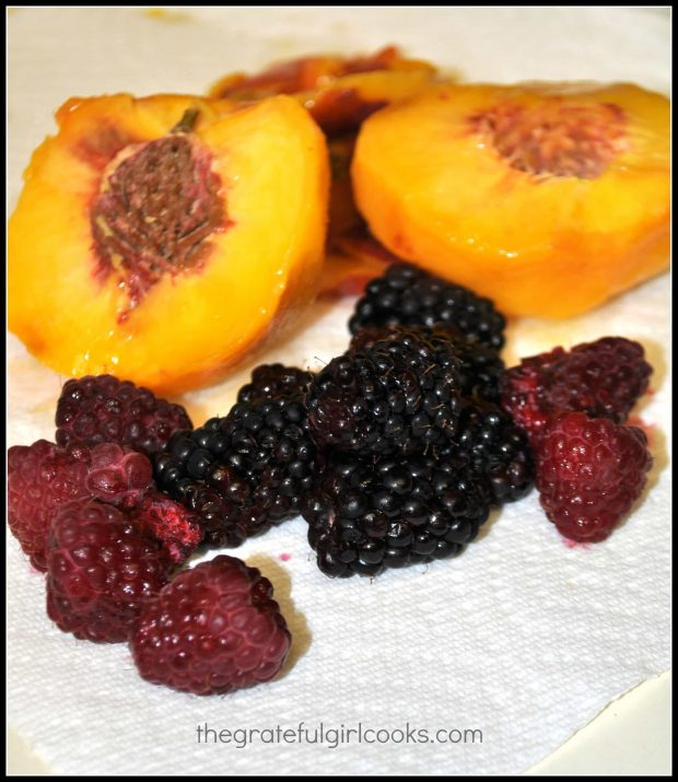 Fresh peaches, raspberries and boysenberries ready for smoothie