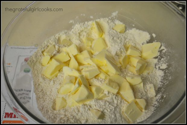 Chunks of cold butter are added to dry ingredients for cinnamon chip scones.