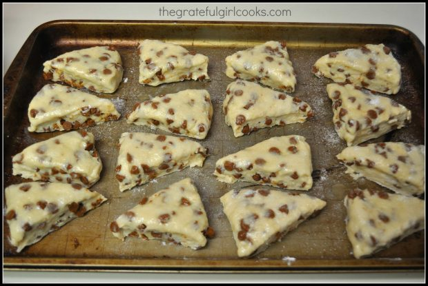 Cinnamon Chip Scones are cut into wedges, and placed on cookie sheet to bake.