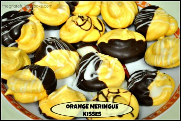 "Light, airy and crisp, these chocolate dipped Orange Meringue Kisses are a fancy ""cookie"" you will enjoy! Easy prep, and a long, low temp. bake time."