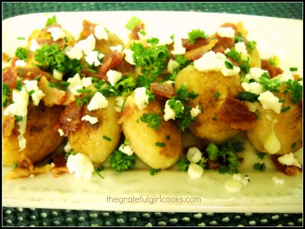 The finished rissole potatoes are garnished with feta, parsley, and crisp bacon.