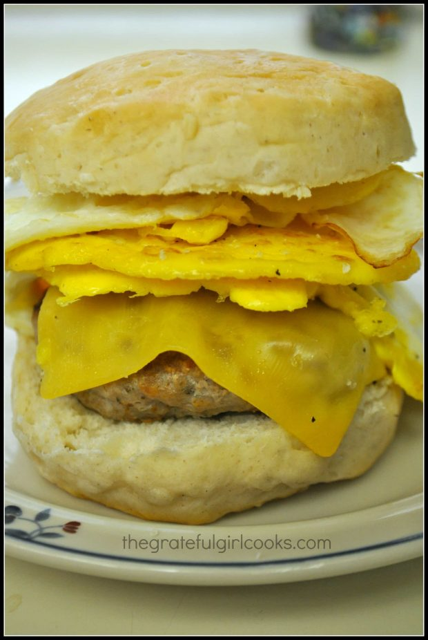 Breakfast sausage patty on biscuit with egg and cheese