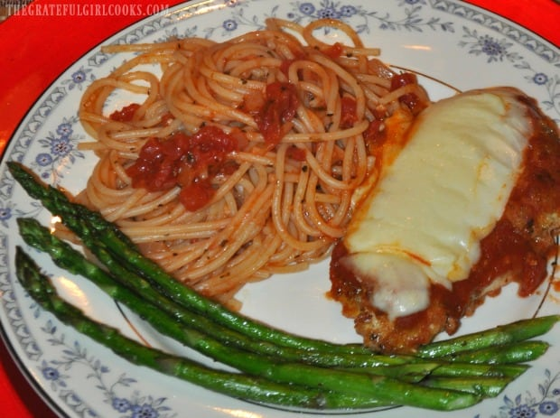 Pasta and asparagus are served alongside Mom's chicken parmigiana.