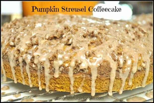 Streusel topping and cinnamon icing enhance this delicious, moist Pumpkin Streusel Coffeecake! Recipe is easy, & makes 2 coffeecakes (perfect for company)!