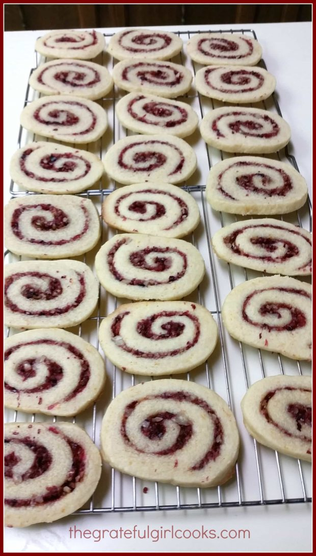 Baked Cranberry-Orange Pinwheel Cookies, cooling on wire racks.