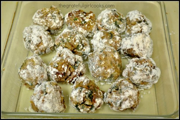 Flour coated meatballs in glass baking dish