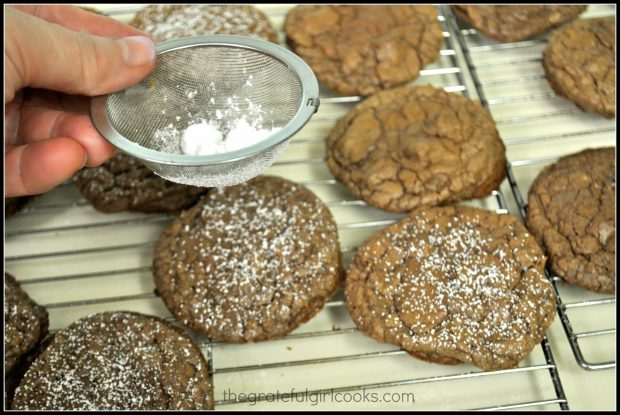 Chocolate Crinkle Cookies are topped with sifted powdered sugar, to finish them off before eating.