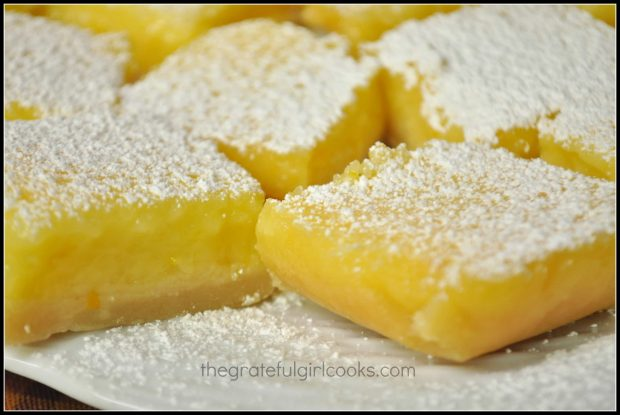 Close up of lemon bars on white plate