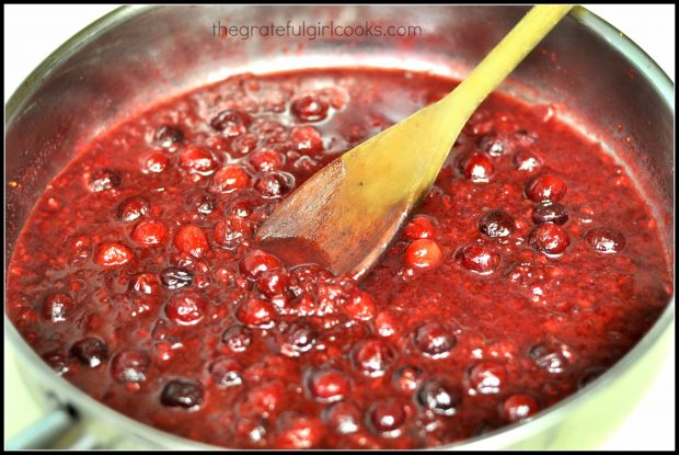 Cranberry-raspberry sauce for pork tenderloin cooking in skillet.