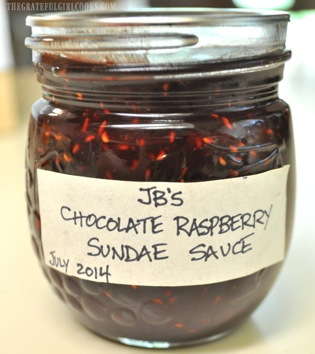 Jar of chocolate raspberry sundae sauce ready to store in pantry.