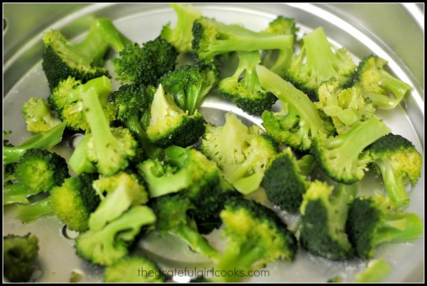 Broccoli is cooked to add to the teriyaki chicken rice bowl.