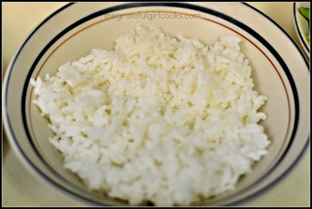 Steamed rice goes on the bottom of the teriyaki chicken rice bowl.