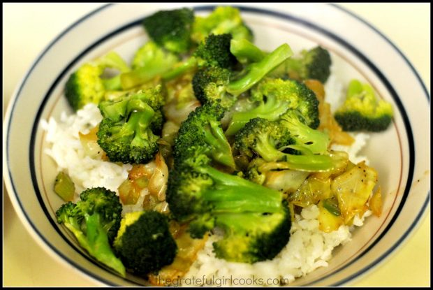 Cooked cabbage and steamed broccoli is added to the rice bowl.