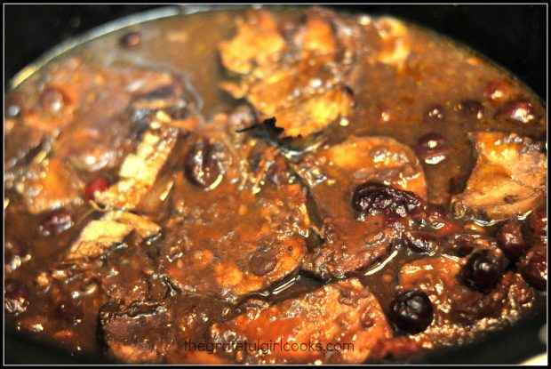 Pieces of pork in crock pot cooking