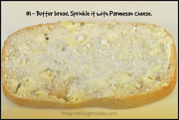 Bread is buttered, then sprinkled with Parmesan cheese.