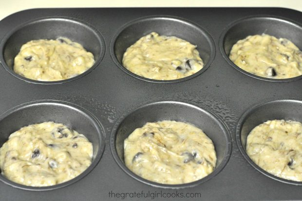 Muffin cups are filled with the batter.