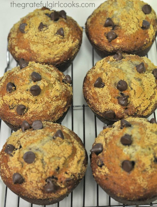 After baking, the chocolate chip banana muffins cool on a wire rack before glazing.