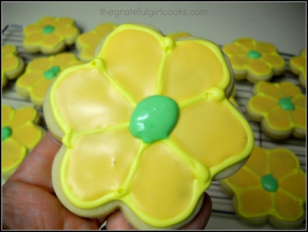 Green icing added to center of flower cookie