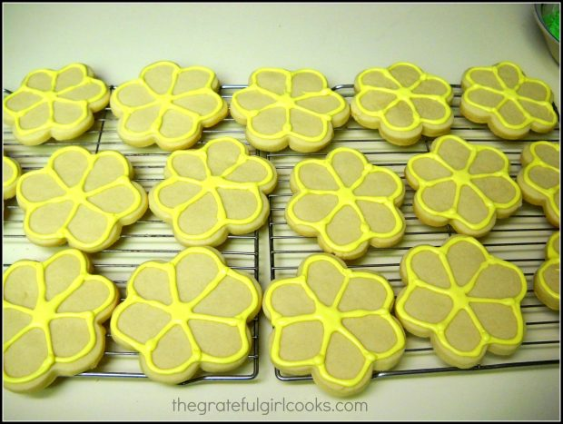 Yellow Icing on edges of flower shaped sugar cookies